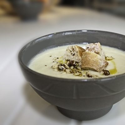 Celeriac and Pink Lady® apple soup with truffle oil and crisp sourdough croutons
